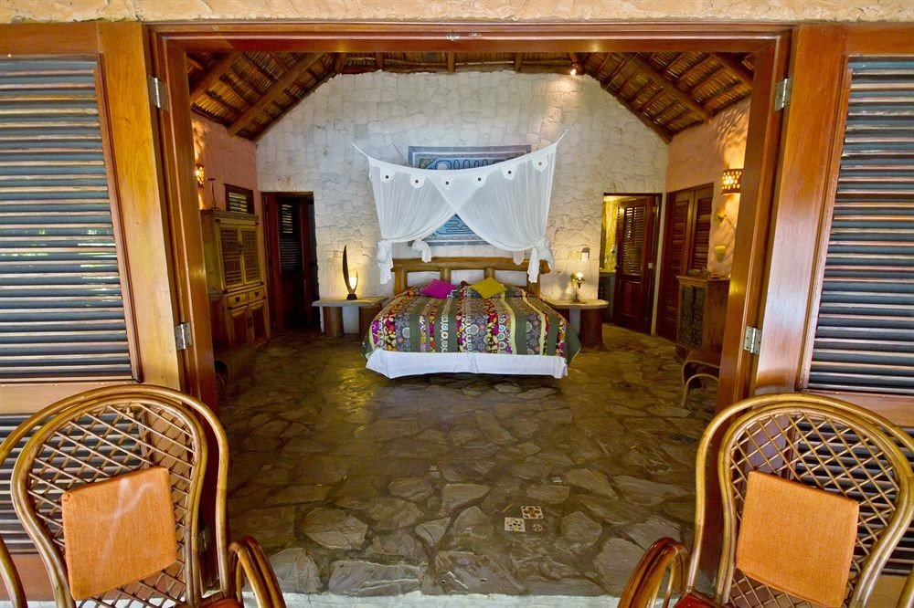Bedroom Country Luxury Romantic Scenic views Suite chair property Dining Resort cottage mansion Villa home dining table