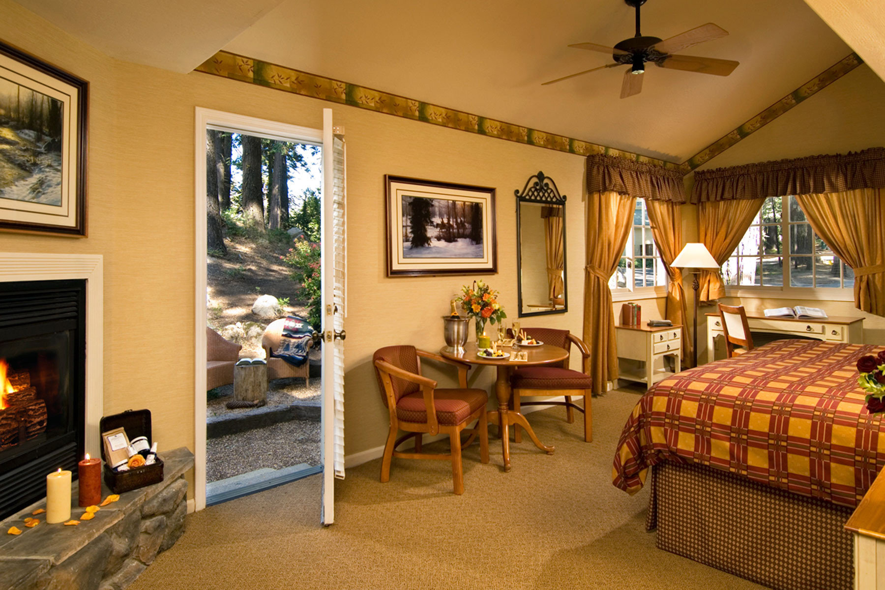 Bedroom Country Fireplace Lodge Patio Rustic property recreation room home living room Villa cottage Resort mansion