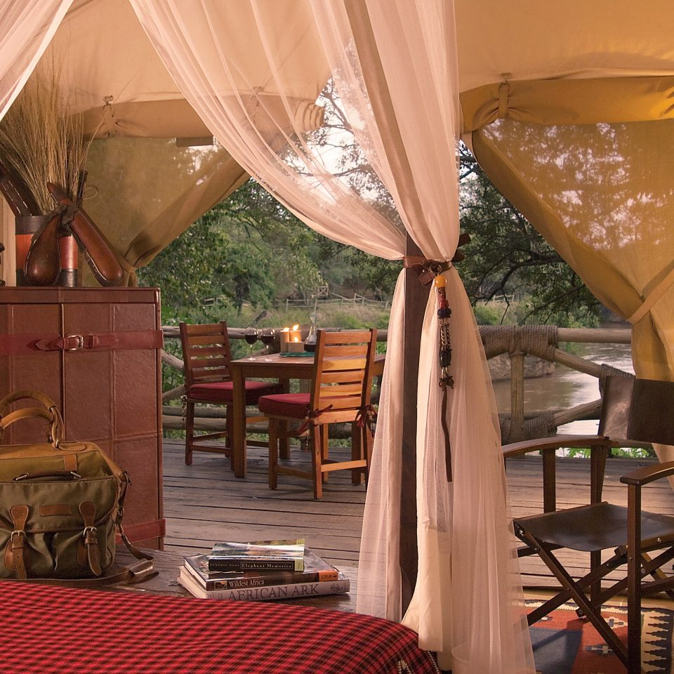 Bedroom Country Lodge Romantic Safari curtain chair property Resort restaurant Suite home living room cottage