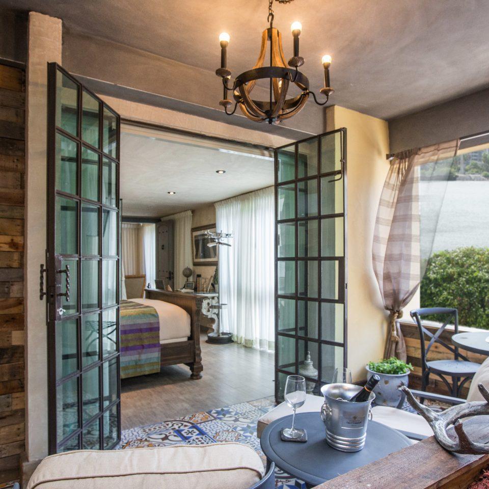 Bedroom Elegant Luxury Patio Romantic Suite Waterfront property house home living room condominium porch Villa mansion cottage Courtyard stone