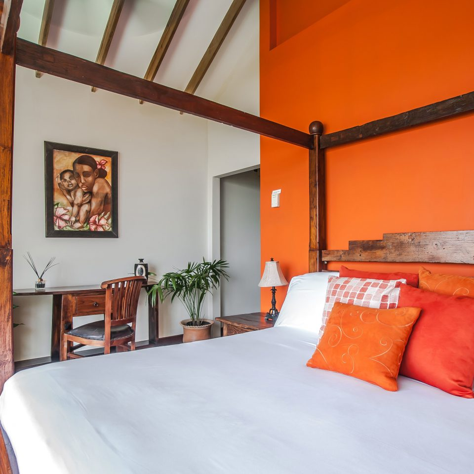 Bedroom Cultural Eco Island Rustic property orange building house cottage Villa home pillow farmhouse Suite