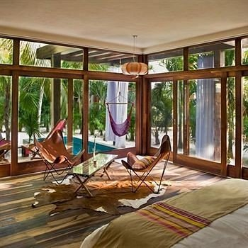 Bedroom property building porch outdoor structure home cottage Deck Resort Villa living room condominium