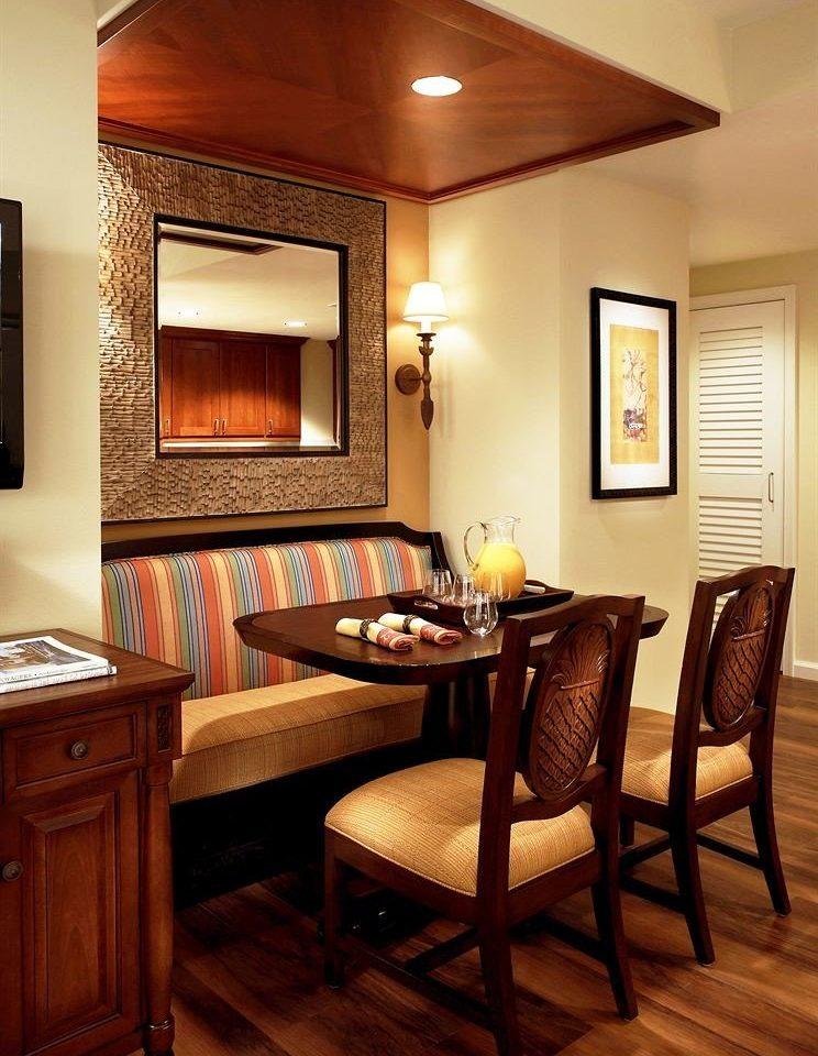 Dining Drink Eat Resort property Suite home hardwood living room cottage wood flooring basement Bedroom