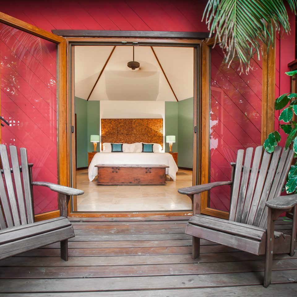 Bedroom Eco Island Rustic Villa chair property house plant living room home porch Resort cottage backyard Dining outdoor structure mansion hacienda Garden