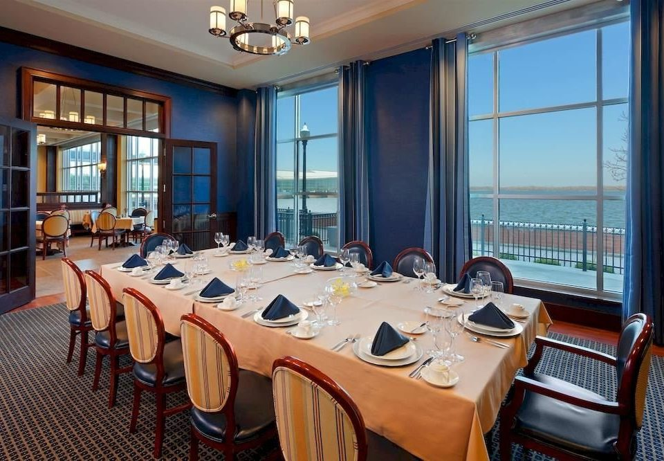 Dining Family Waterfront chair conference hall restaurant function hall Suite convention center Bedroom overlooking dining table