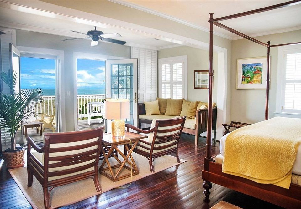 chair property living room Dining condominium home Suite hardwood Bedroom cottage Resort