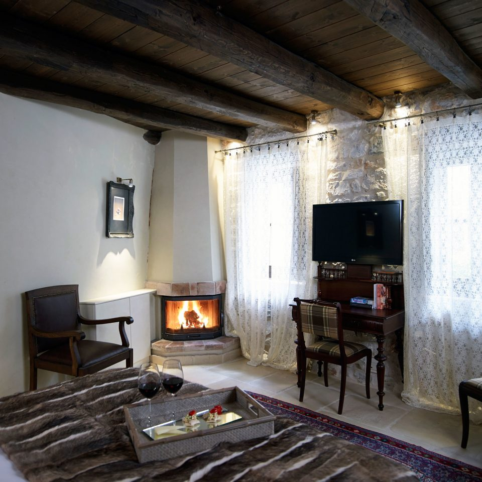 Bedroom Drink Fireplace Forest Mountains Romance Rustic Scenic views property building house living room home cottage loft farmhouse Villa
