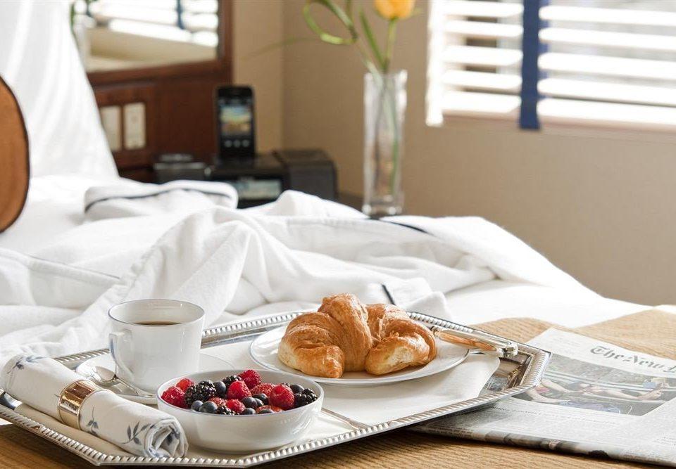 Bedroom Lounge Luxury Modern Suite coffee cup plate breakfast pastry lunch Drink baking food brunch dessert dining table