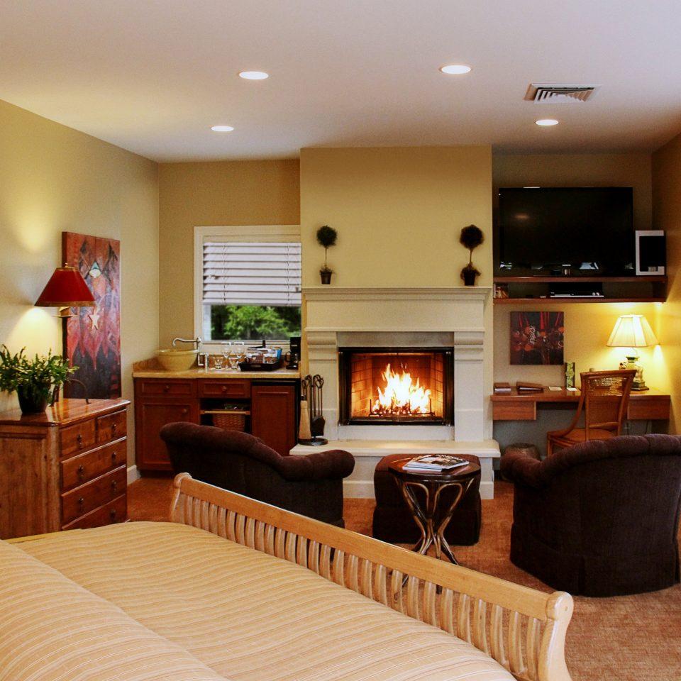 Bedroom Elegant Hip Luxury Modern Suite sofa property home living room hardwood cottage Fireplace condominium flat