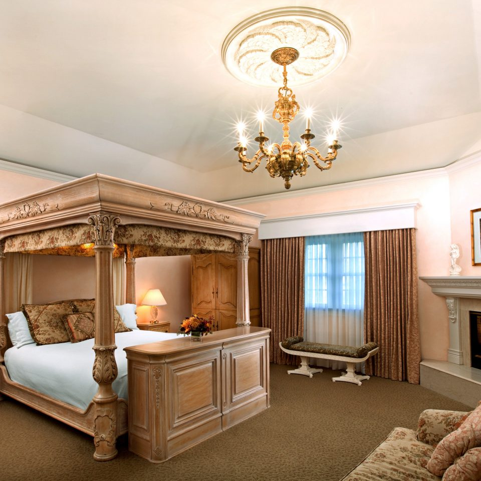 Bedroom Elegant Fireplace Historic Honeymoon Inn Romance Romantic living room property home Suite mansion cottage