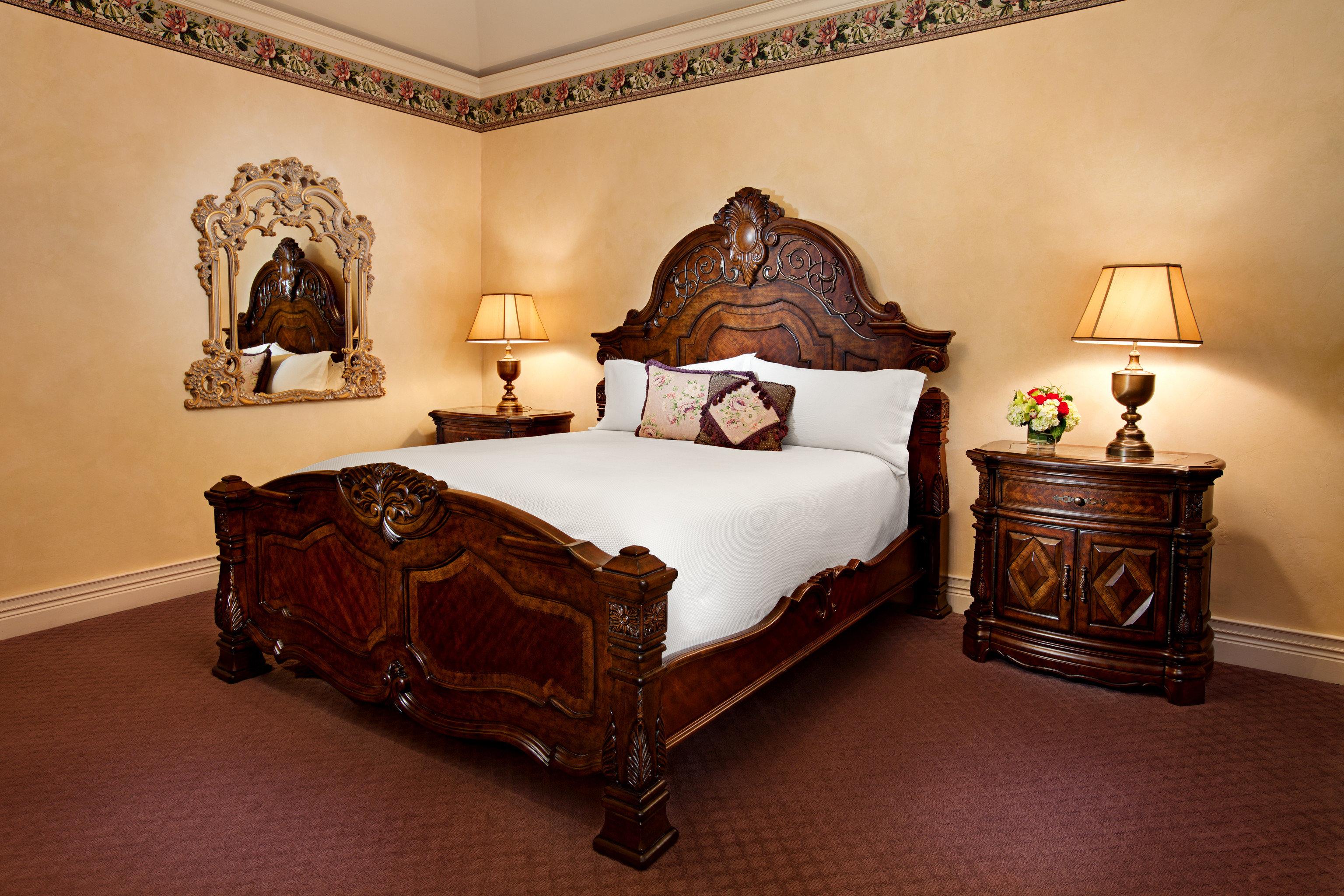 Bedroom Elegant Fireplace Historic Inn Romantic property hardwood Suite bed sheet bed frame living room wood flooring flooring antique lamp containing