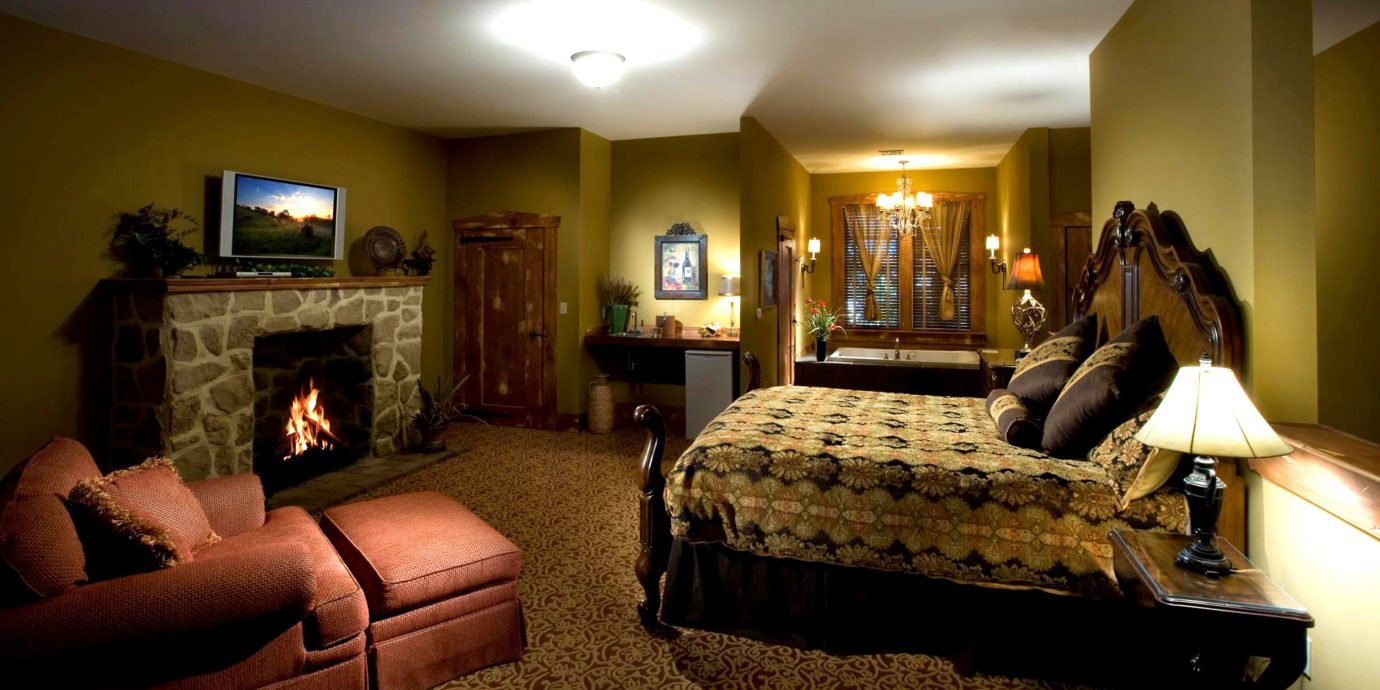 Bedroom Elegant Fireplace Inn Lounge Rustic sofa property Suite home living room mansion cottage lamp flat