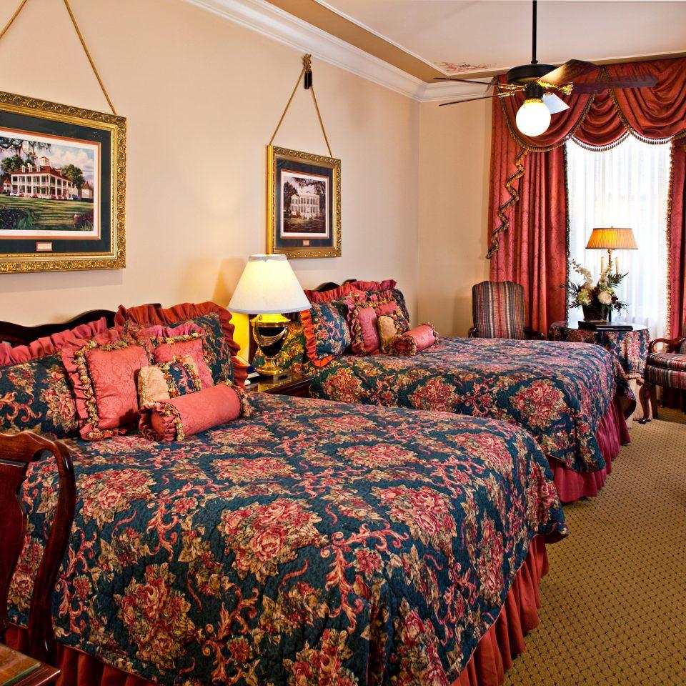 Bedroom Elegant Historic Resort property cottage home Suite colorful bed sheet living room lamp