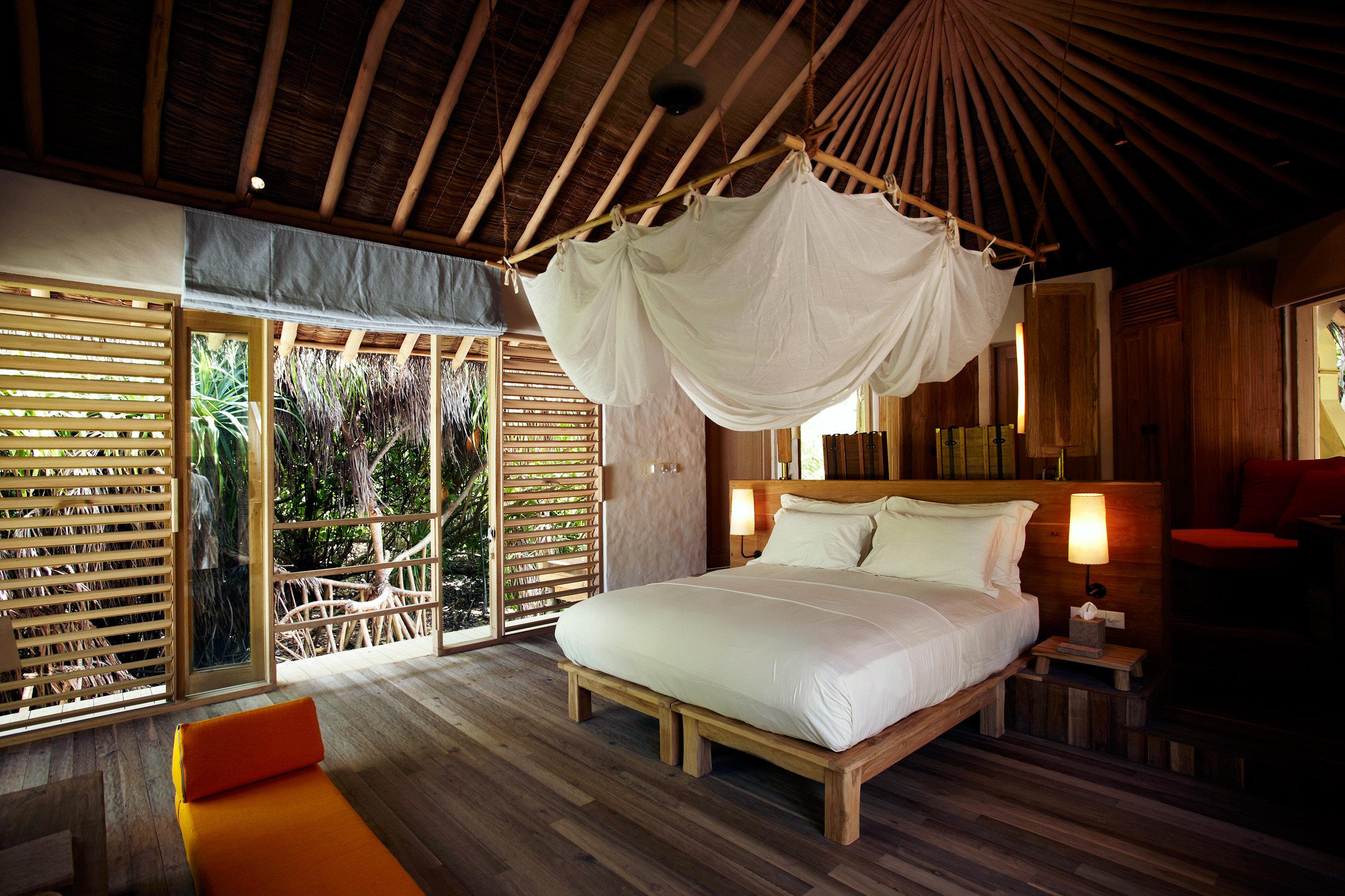 Bedroom Elegant Hotels Islands Luxury Patio Scenic views Suite Trip Ideas property Resort Villa cottage eco hotel