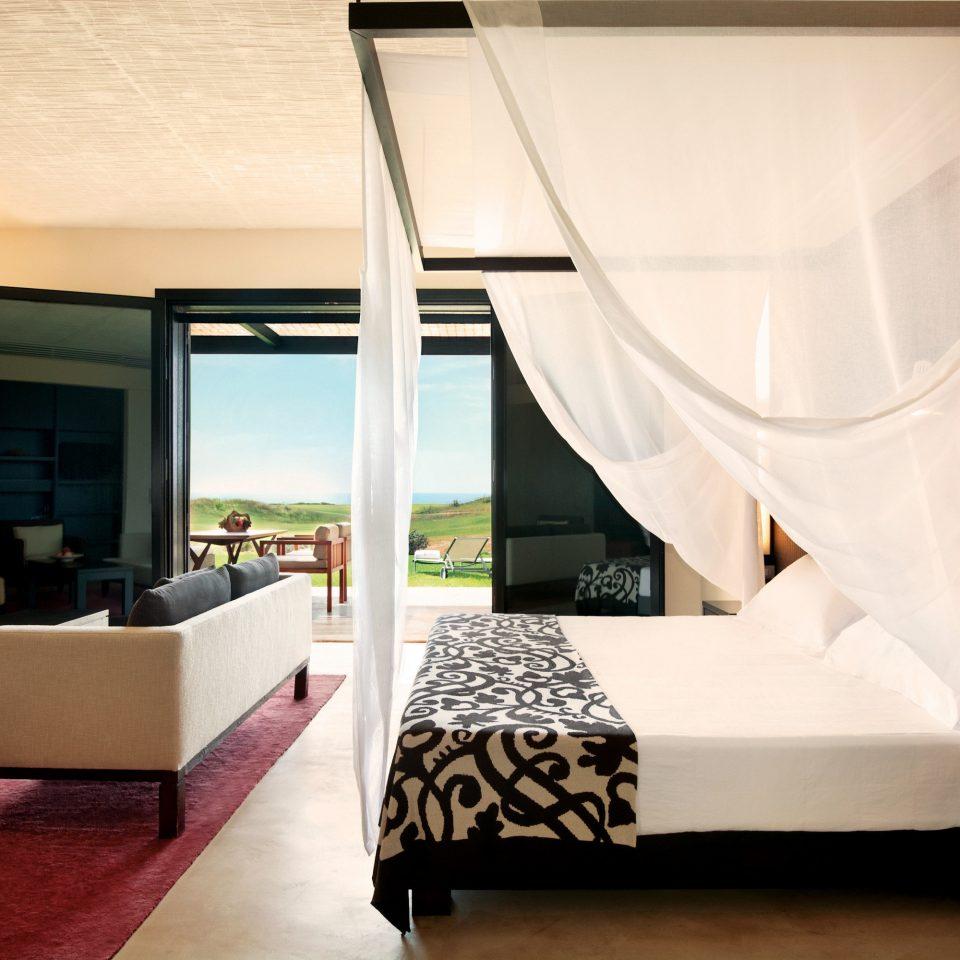 Bedroom Elegant Hotels Luxury Luxury Travel Scenic views Suite property living room curtain