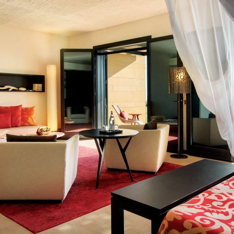 Bedroom Elegant Luxury Scenic views Suite property living room red curtain home Villa condominium