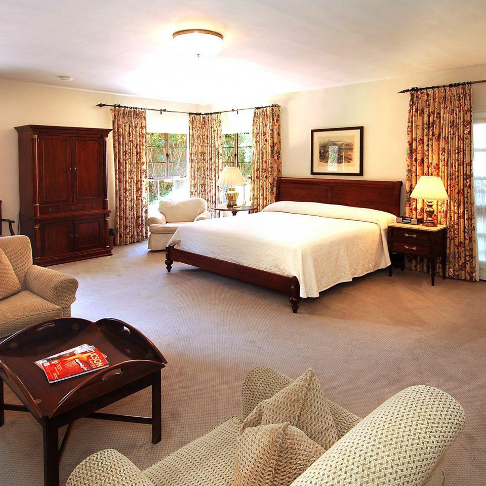Bedroom Elegant Rustic Suite sofa property living room scene home cottage hardwood Villa rug flat