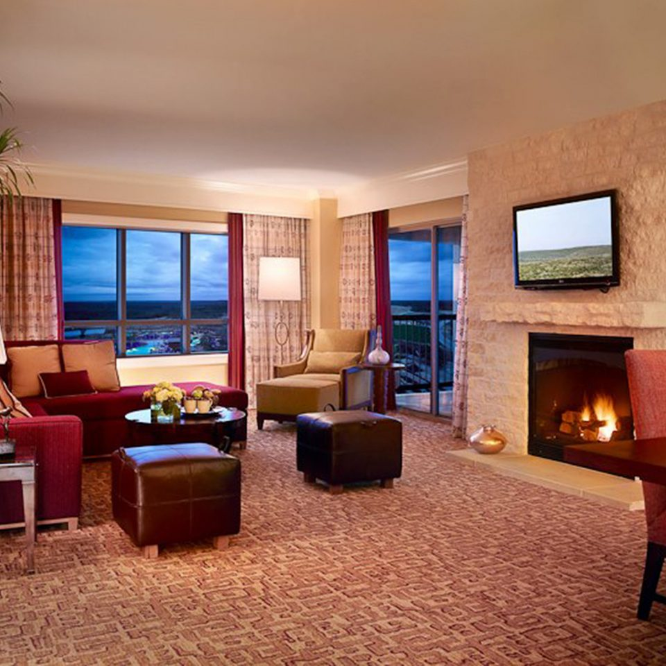 Family Fireplace Lounge Resort Scenic views Suite chair property living room home Villa cottage condominium Bedroom