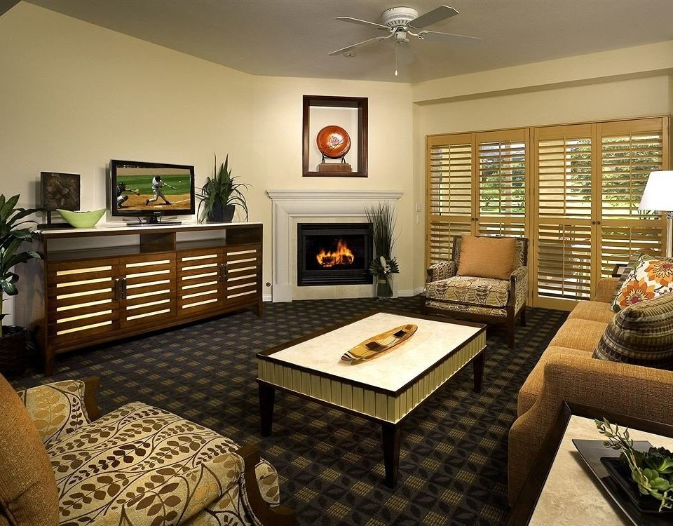 Family Fireplace Resort sofa living room property home hardwood cottage condominium Bedroom recreation room Suite Modern
