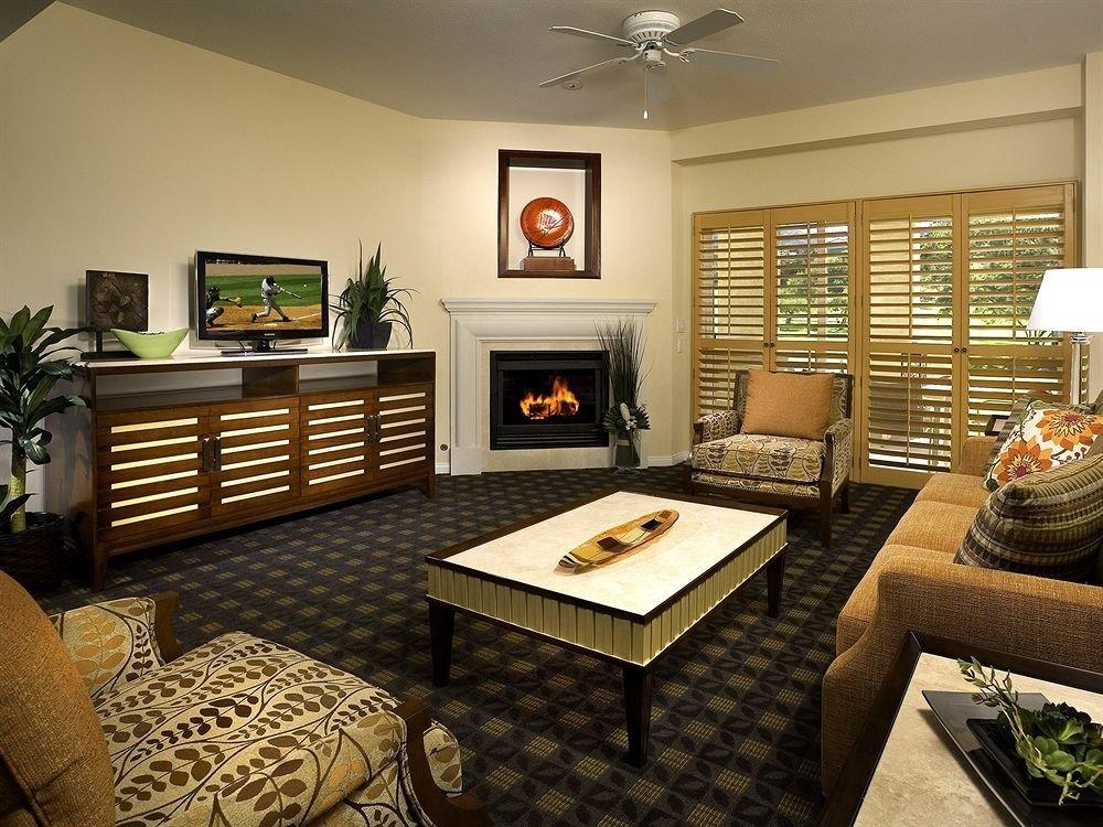 Family Fireplace Resort sofa living room property home hardwood cottage condominium Bedroom recreation room Suite Modern