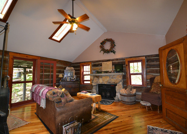 sofa Fireplace property living room fire home house cottage Bedroom hardwood recreation room log cabin farmhouse hard