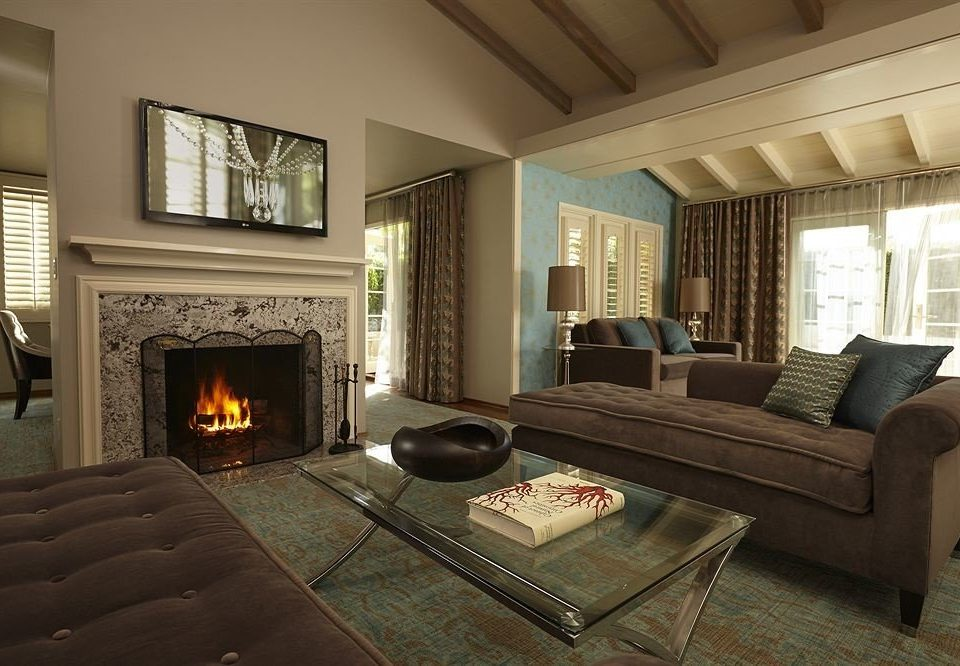 Fireplace sofa fire living room property home hardwood cottage hearth Bedroom mansion stone