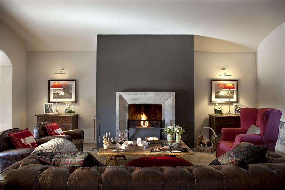 sofa living room property home Fireplace hardwood cottage Bedroom flat leather