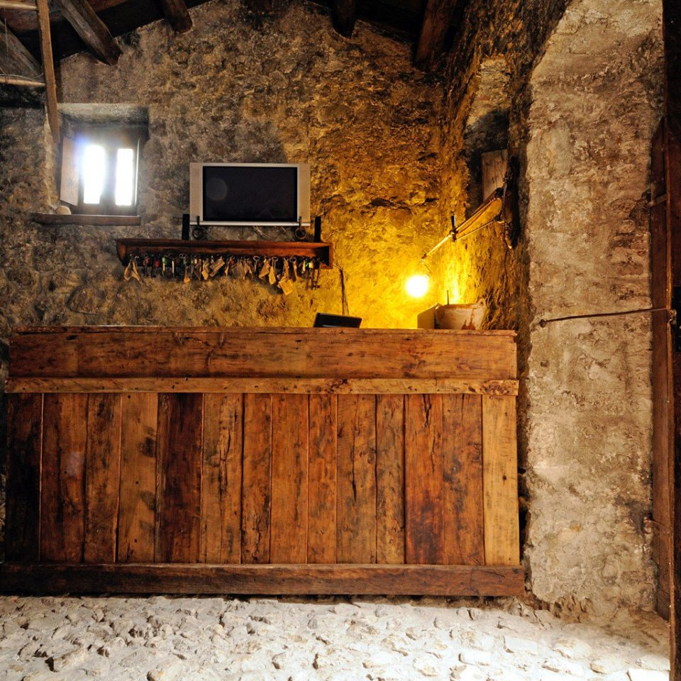 Bedroom Honeymoon Romance Romantic Rustic man made object house Fireplace lighting home stone cottage ancient history basement