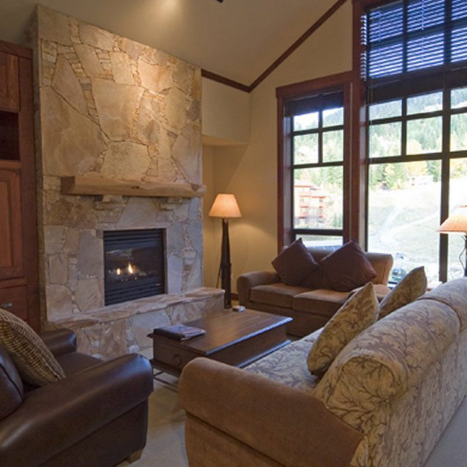 Bedroom Fireplace Lodge Mountains Outdoor Activities Scenic views Suite sofa living room property home hardwood cottage condominium mansion