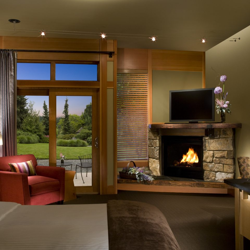Bedroom Fireplace Lodge Resort Romance Romantic Rustic property living room home house hardwood Suite cottage condominium