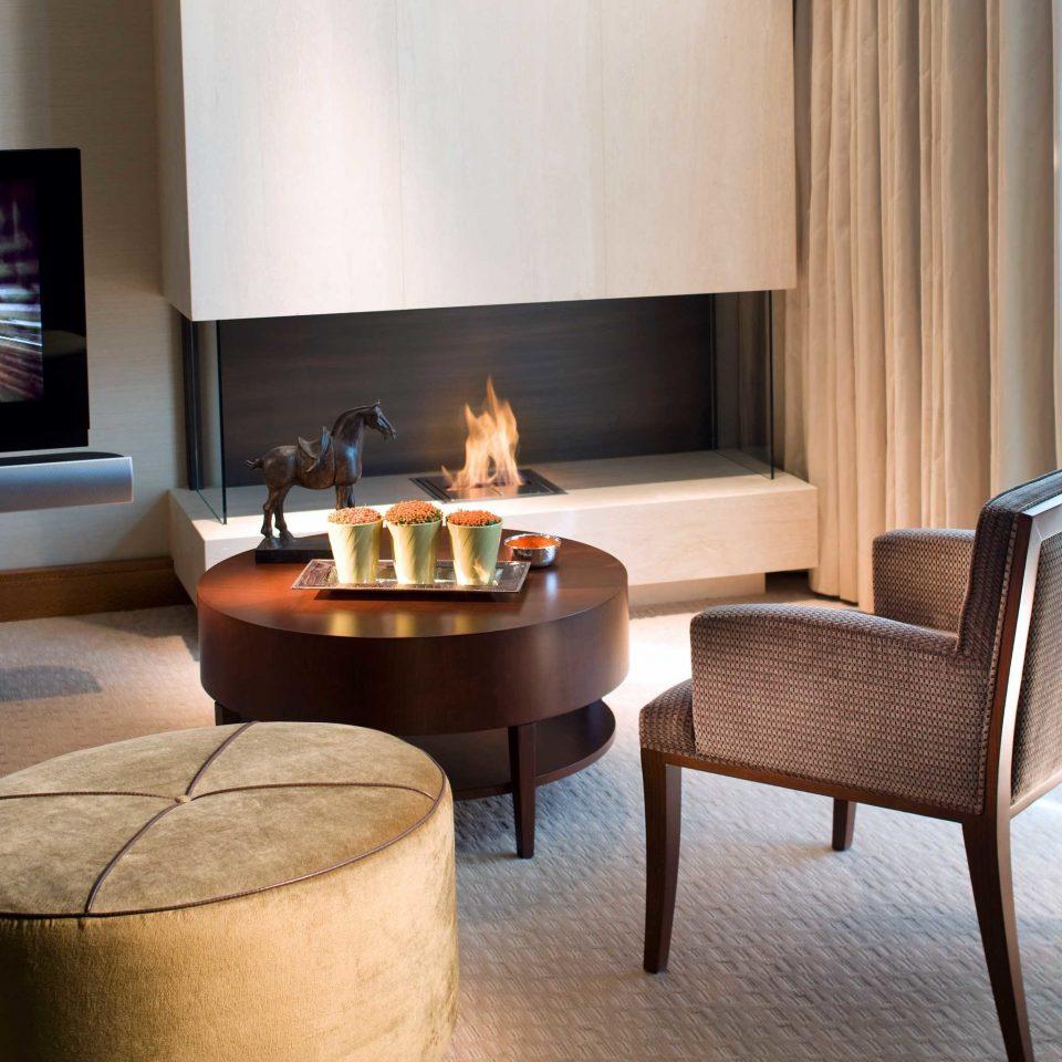 Fireplace Luxury Resort property living room hardwood hearth curtain home lighting wood flooring flooring Suite Bedroom