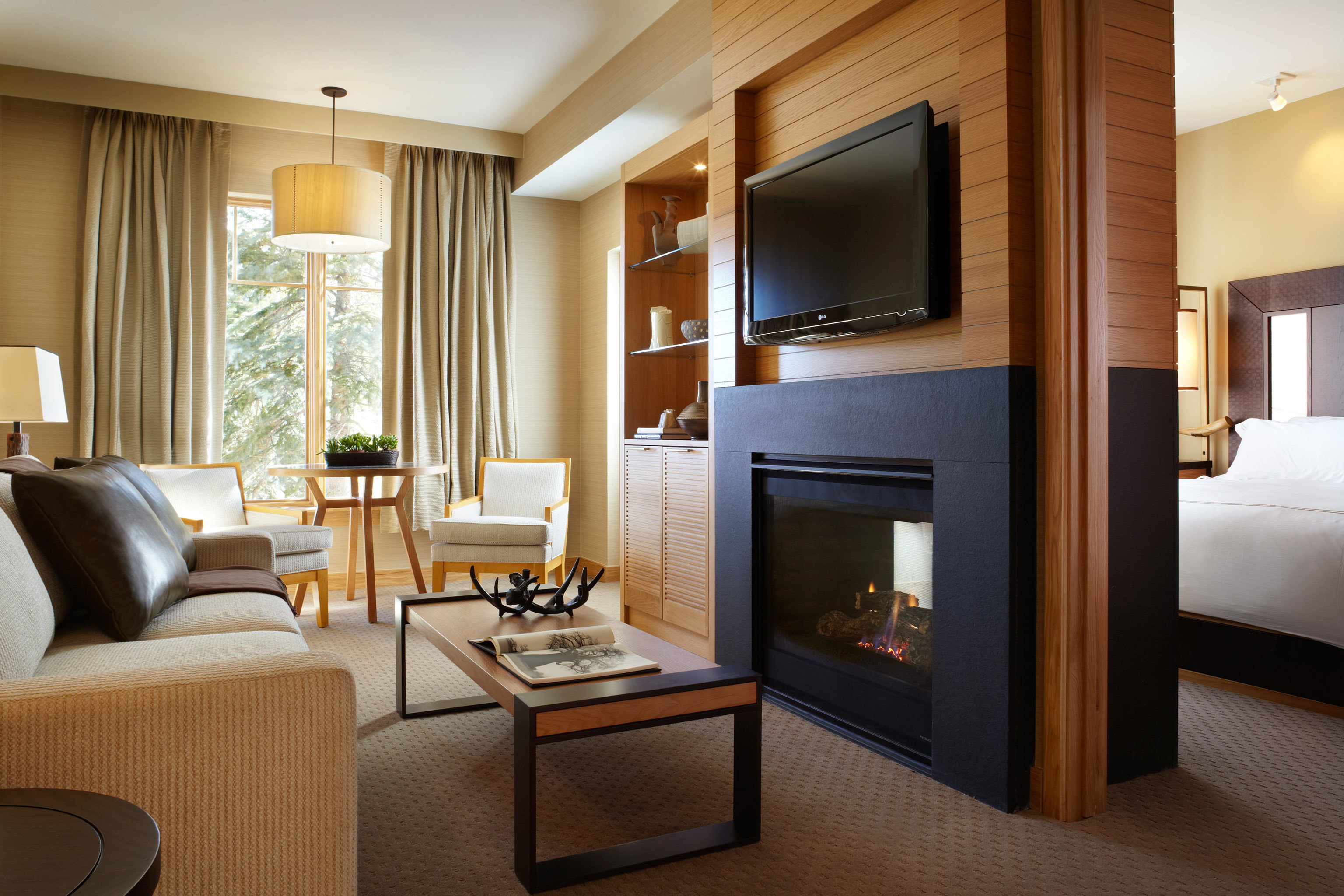 Bedroom Fireplace Luxury property living room home Suite condominium hardwood
