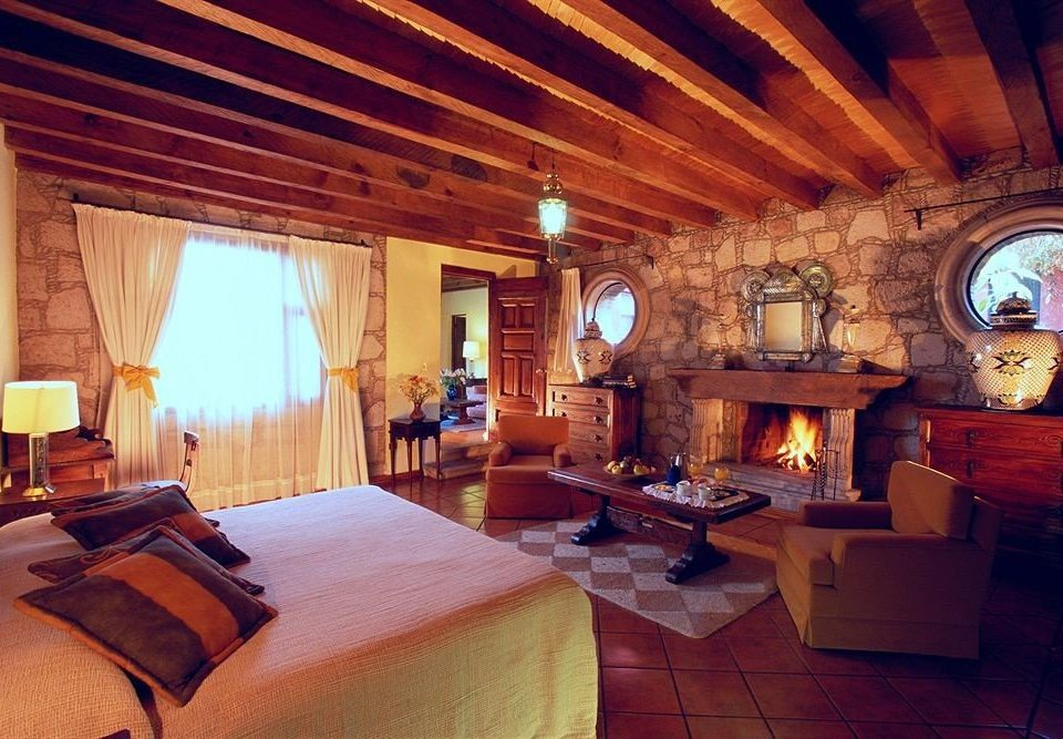 Bedroom Romantic Rustic sofa property Fireplace building house Villa cottage home living room Resort log cabin mansion