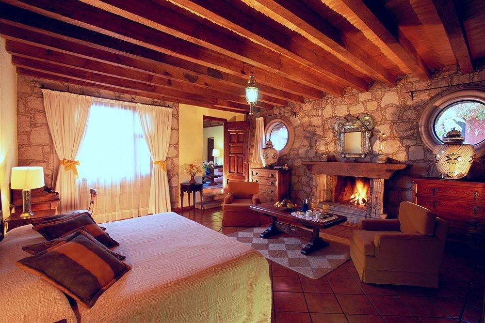 Bedroom Romantic Rustic sofa property Fireplace building house Villa cottage home living room Resort log cabin mansion