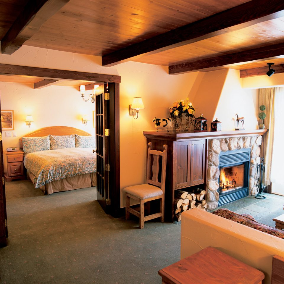 Bedroom Fireplace Rustic property living room house home cottage Villa Suite recreation room