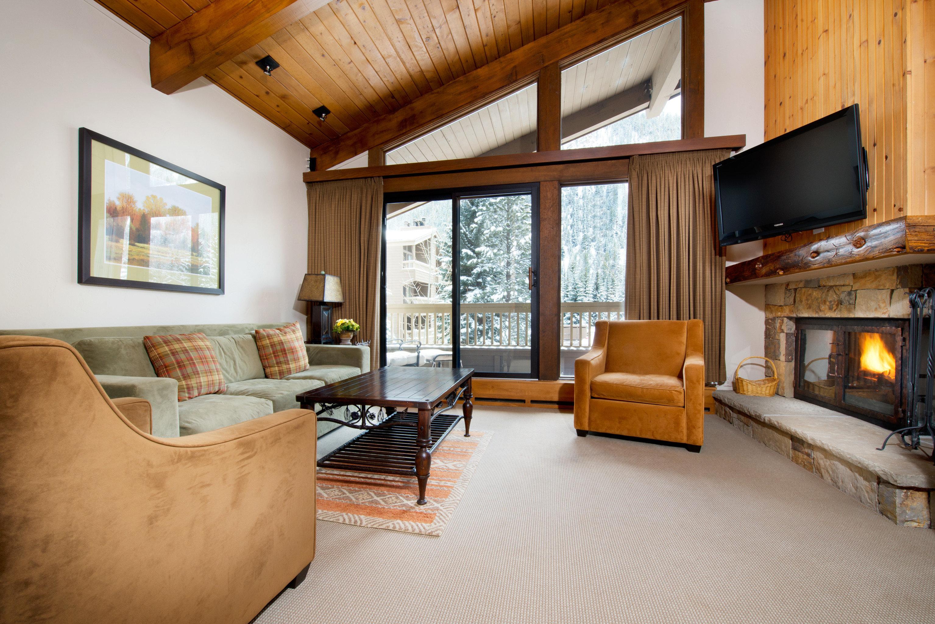 Rustic sofa property chair home living room house cottage hardwood Fireplace Villa farmhouse Bedroom Suite condominium