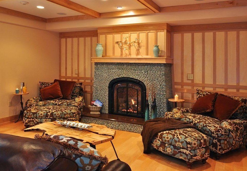 sofa Fireplace property living room home hardwood cottage Bedroom Suite basement leather