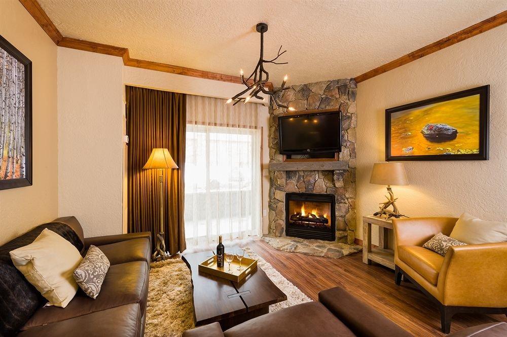 sofa Fireplace fire property living room Suite home Bedroom cottage hardwood Villa flat stone