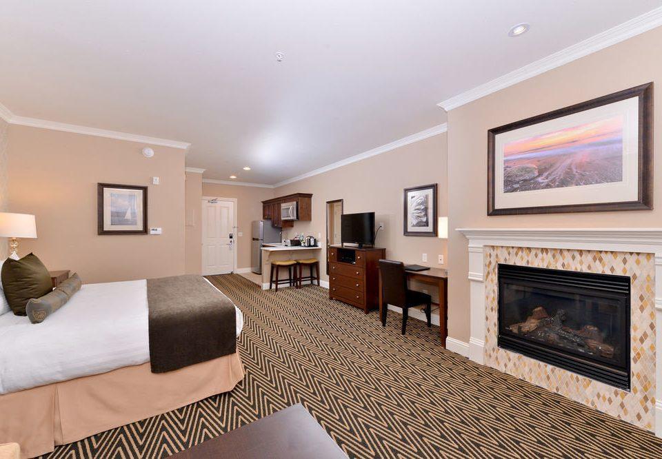 sofa property living room Suite Fireplace home hardwood condominium cottage Villa Bedroom flat