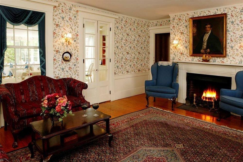 sofa Fireplace living room fire property home house hardwood cottage Suite mansion Villa rug Bedroom