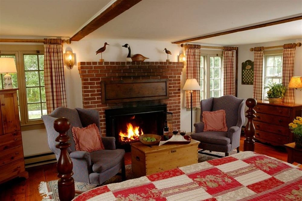 Fireplace fire sofa living room property home cottage Villa farmhouse Bedroom