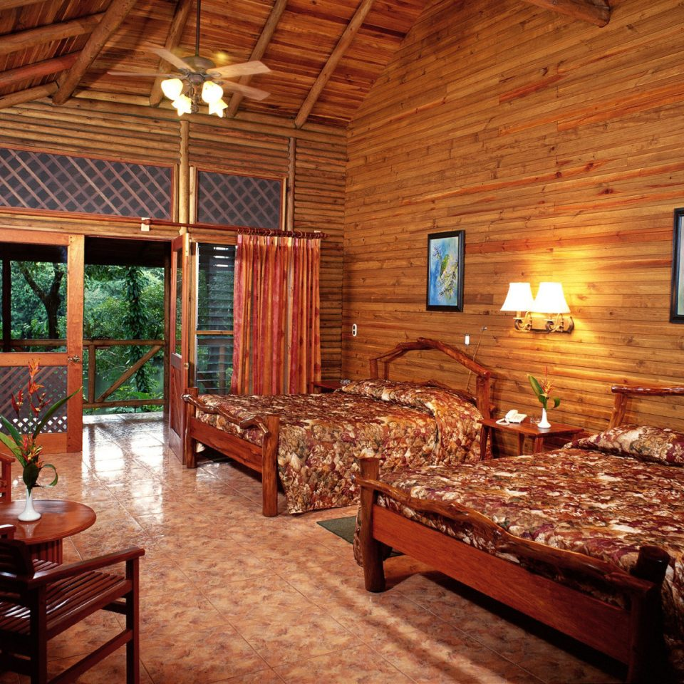 Bedroom Forest Jungle Lake Lodge Rustic Waterfront property building log cabin cottage recreation room farmhouse home billiard room living room Villa Resort