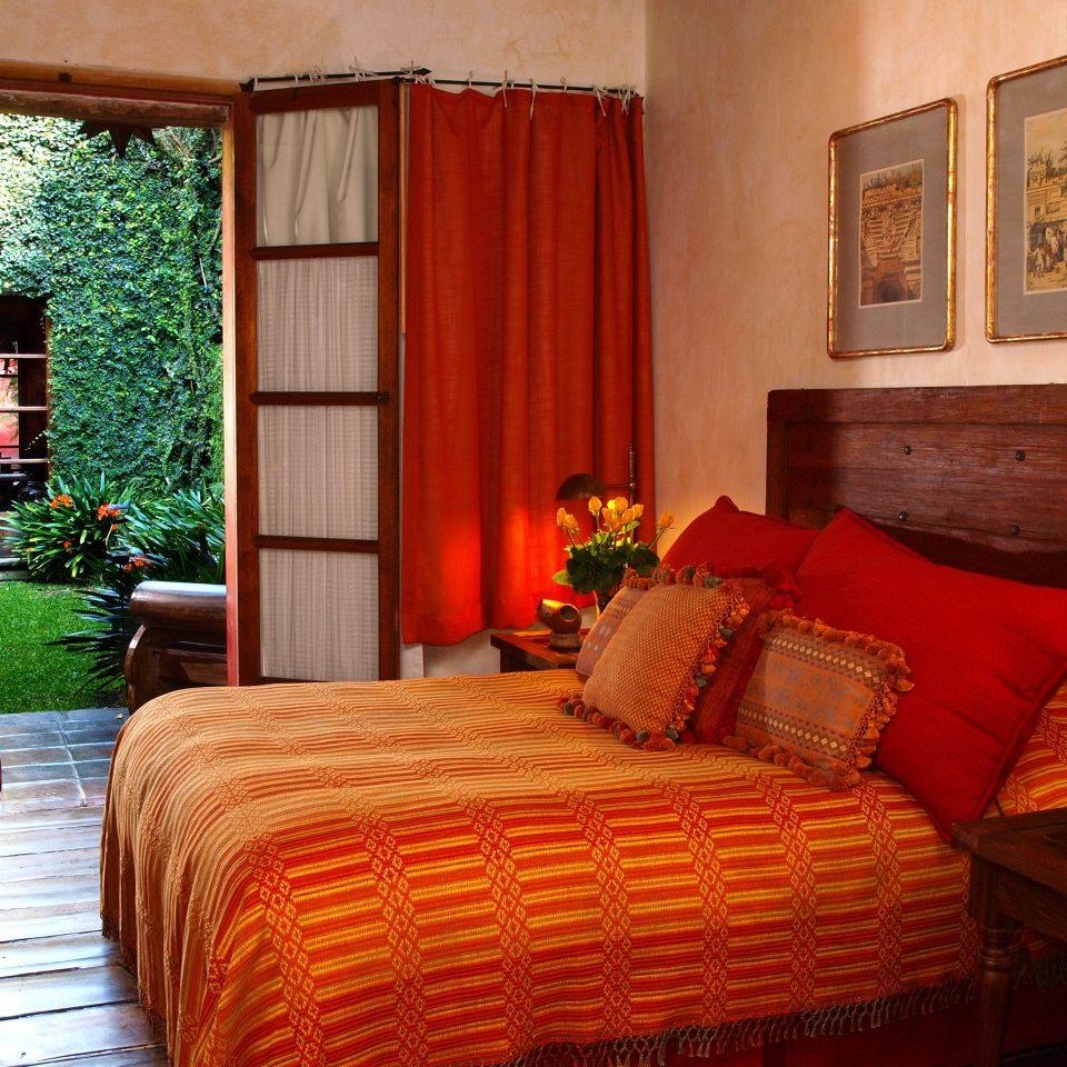 Bedroom Garden Grounds Rustic Scenic views property Suite living room home cottage bed sheet Resort Villa orange