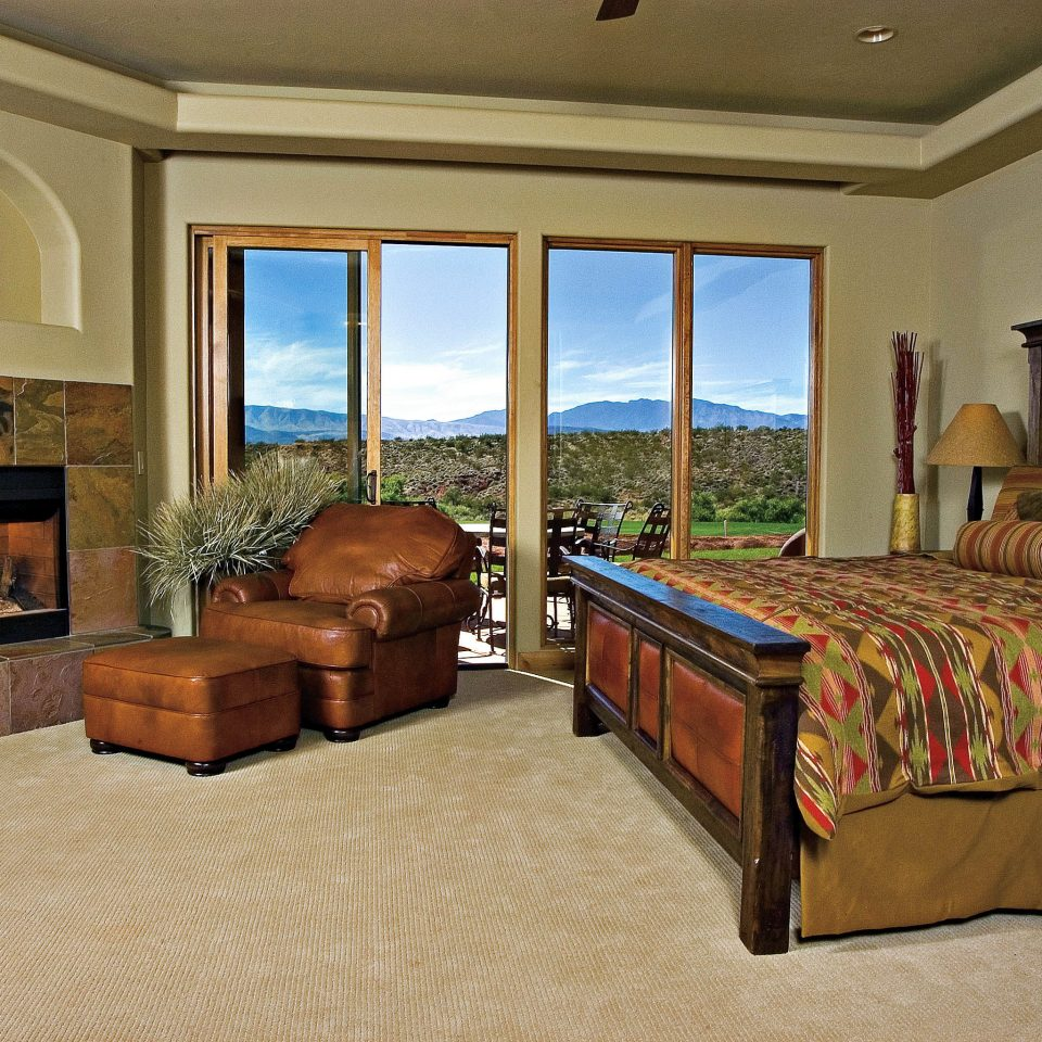 Bedroom Golf Mountains Nature Outdoor Activities Patio Resort Scenic views sofa property Suite home living room hardwood cottage Villa mansion containing