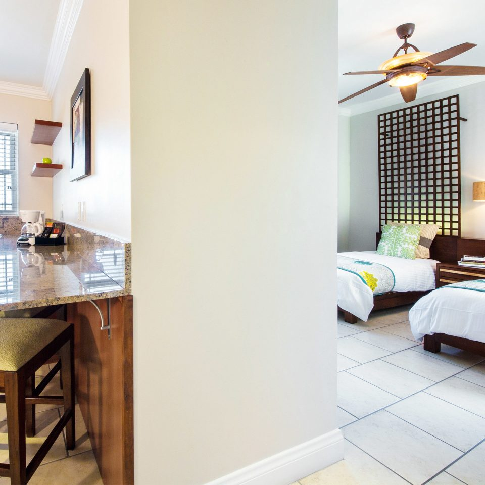 Grounds Resort property cottage home Suite condominium Villa living room farmhouse Bedroom