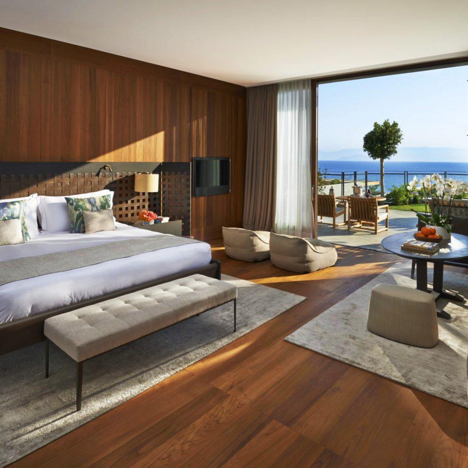 Bedroom Hip Hotels Luxury Modern Romantic Scenic views Suite sofa property living room condominium home hardwood Villa wood flooring cottage flat