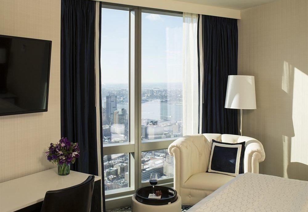 Bedroom Hip Lounge Luxury Suite sofa property living room home condominium curtain window treatment cottage flat