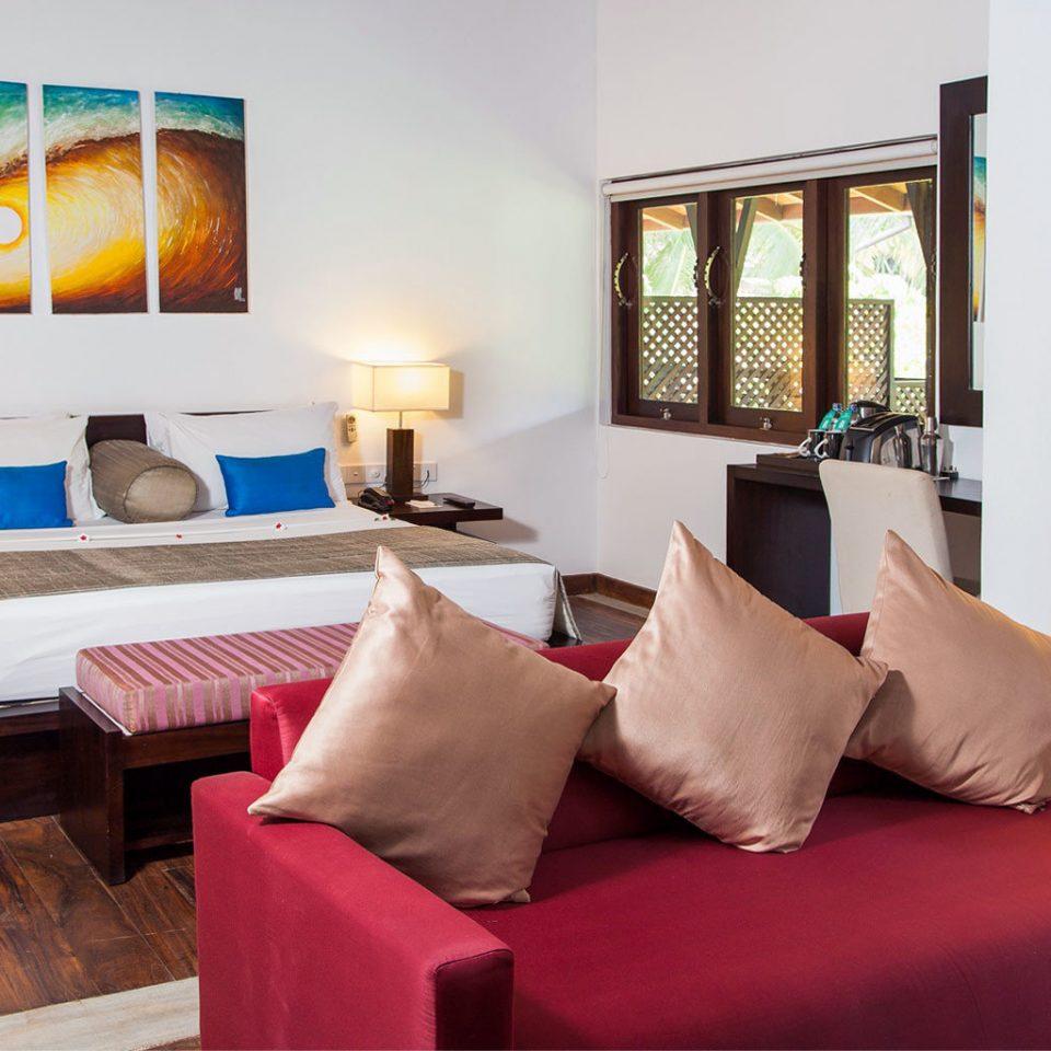Bedroom Hip Lounge Modern Suite sofa property living room red home Villa cottage Resort nice