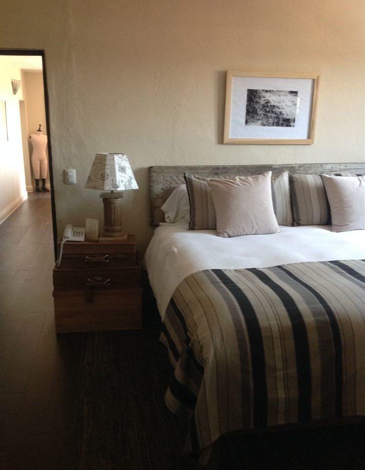 Bedroom Hip Luxury Suite property home hardwood cottage bed sheet pillow living room wood flooring