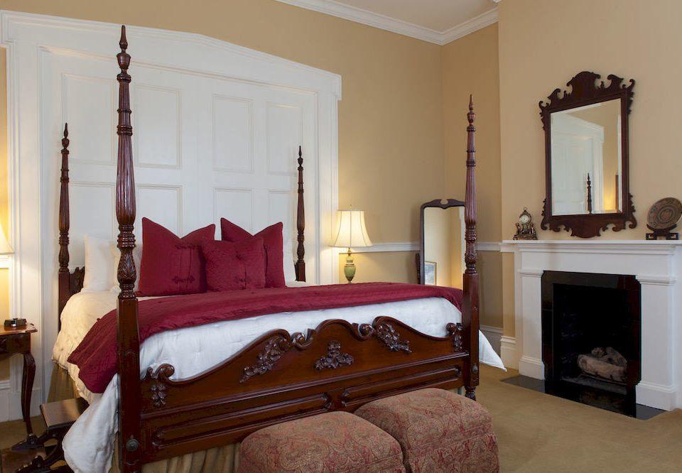 Bedroom Historic Inn property red living room home hardwood cottage Villa Suite